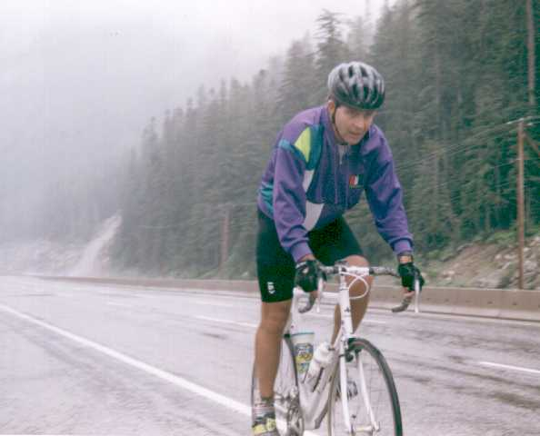 Dr. Andries Botha rides in rain